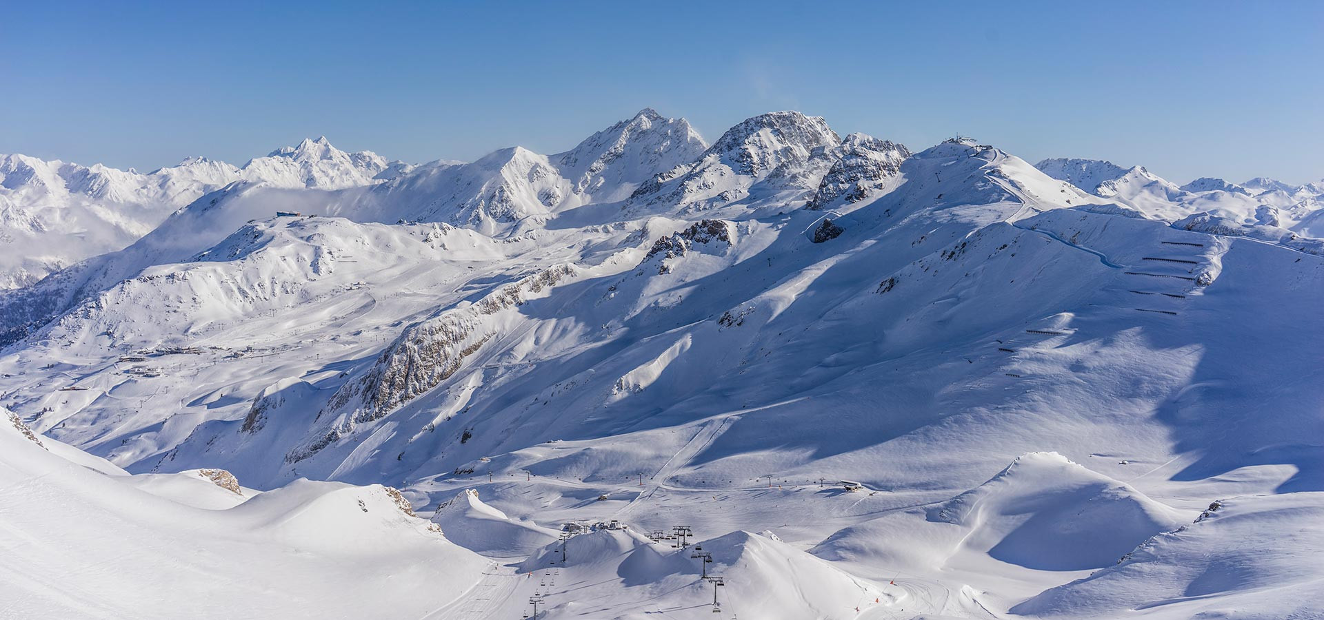 Numerous pristine  slopes with deep powder snow and unique panoramic views